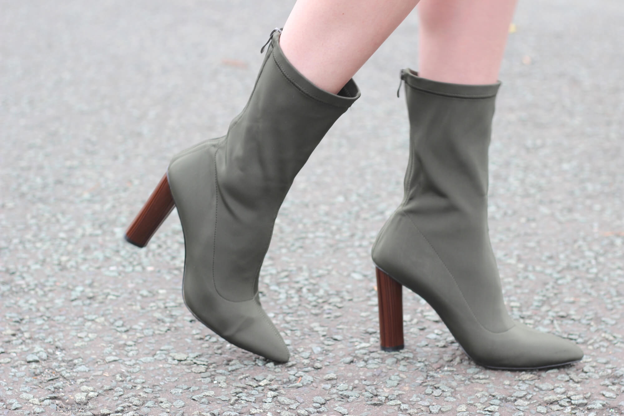 Khaki high heel ankle boots on street style blogger