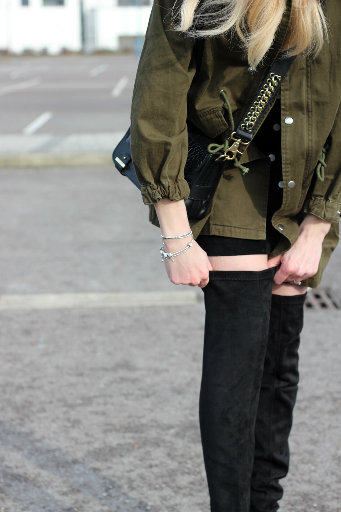 how to wear over the knee boots and a khaki army jacket