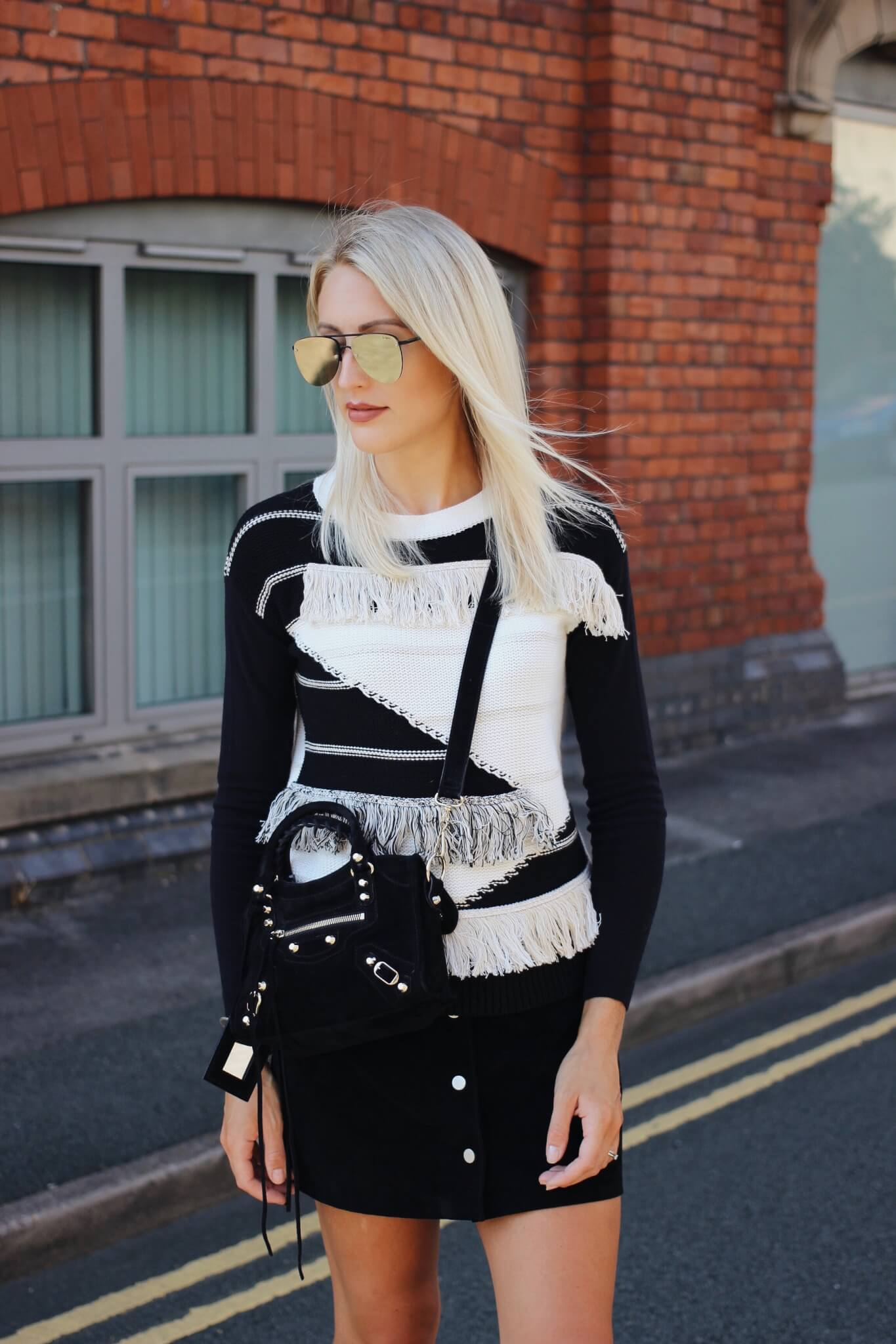 monochrome street style in fringed jumper on fashion blogger
