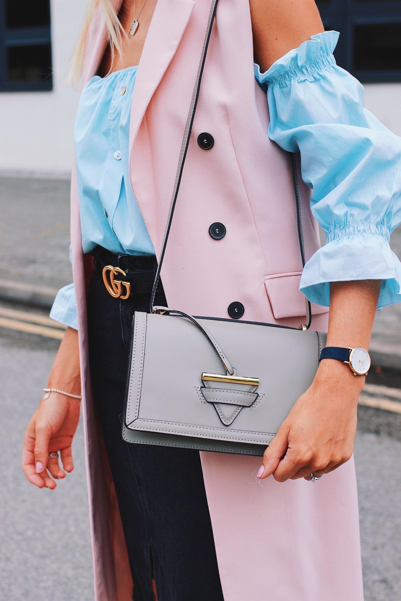 Camelia Roma Loewe Lookalike Handbag Pink Sleeveless blazer and tanned skin