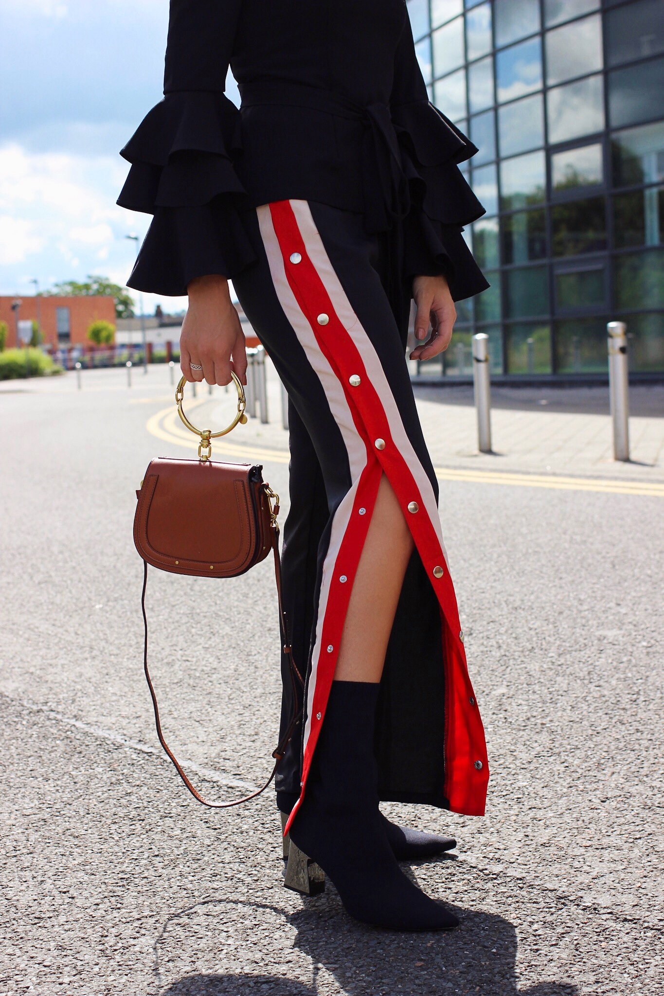 Popper track pants from Missy Empire and Zara sock boots street style