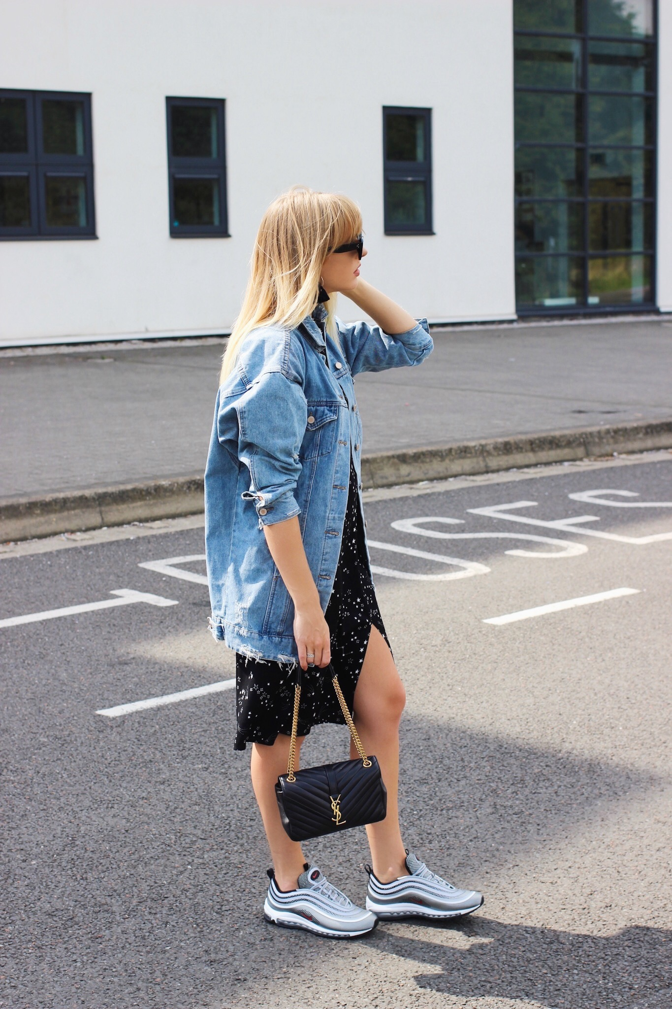 How to style trainers with a dress and oversize denim jacket on fashion blogger charlotte buttrick