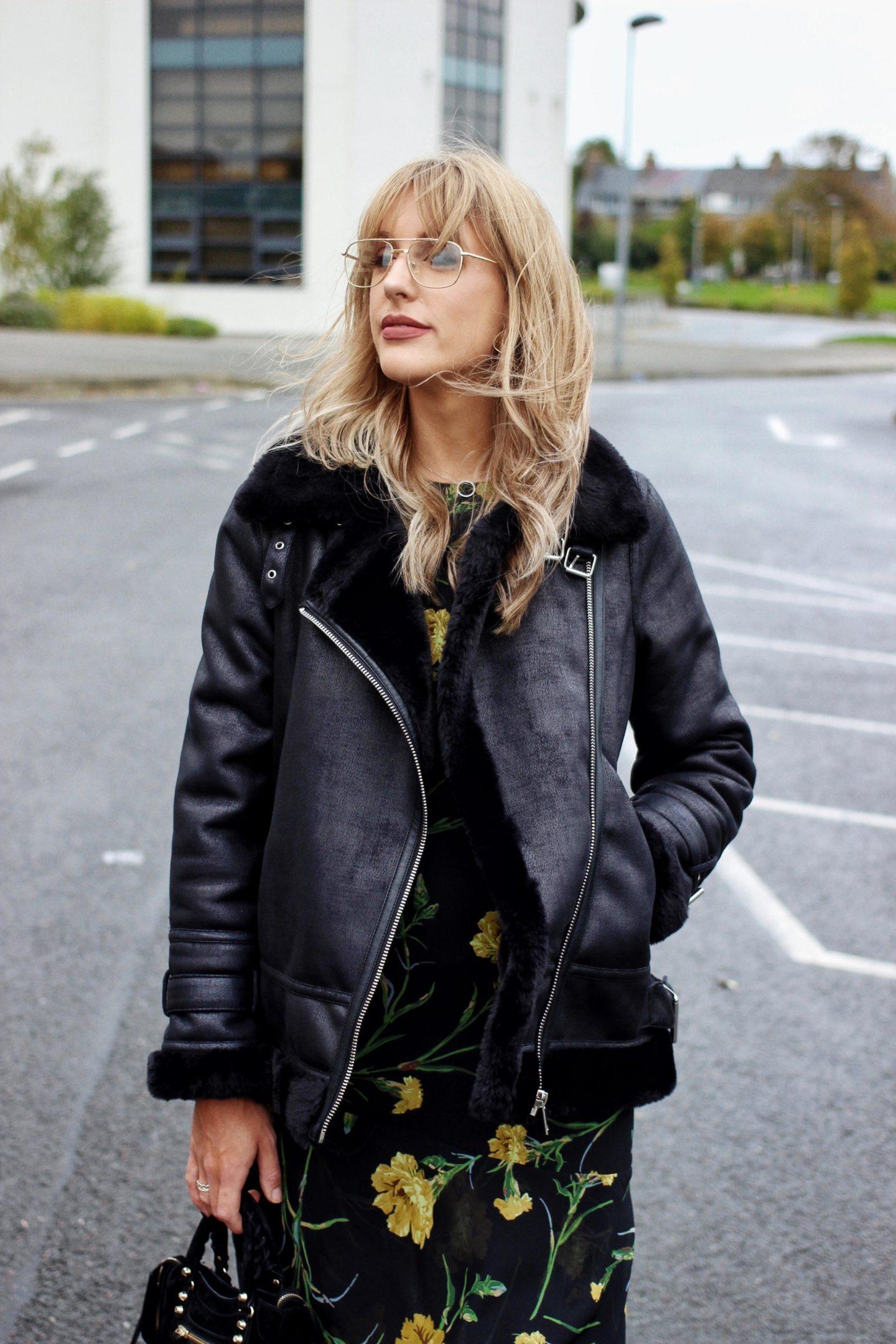 high street style blogger Charlotte Buttrick in Warehouse oversized biker jacket