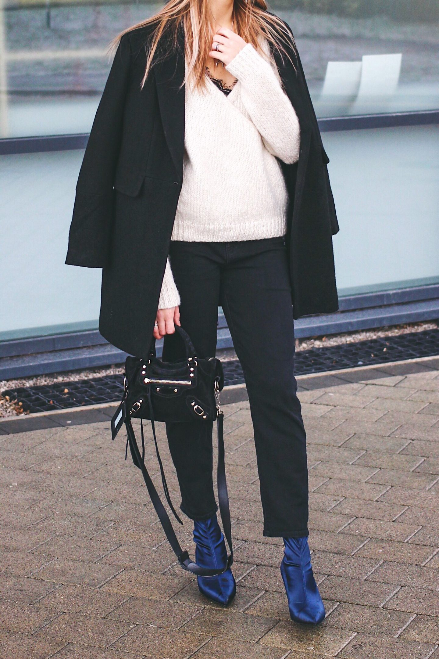 black jeans and monochrome minimal outfit street style