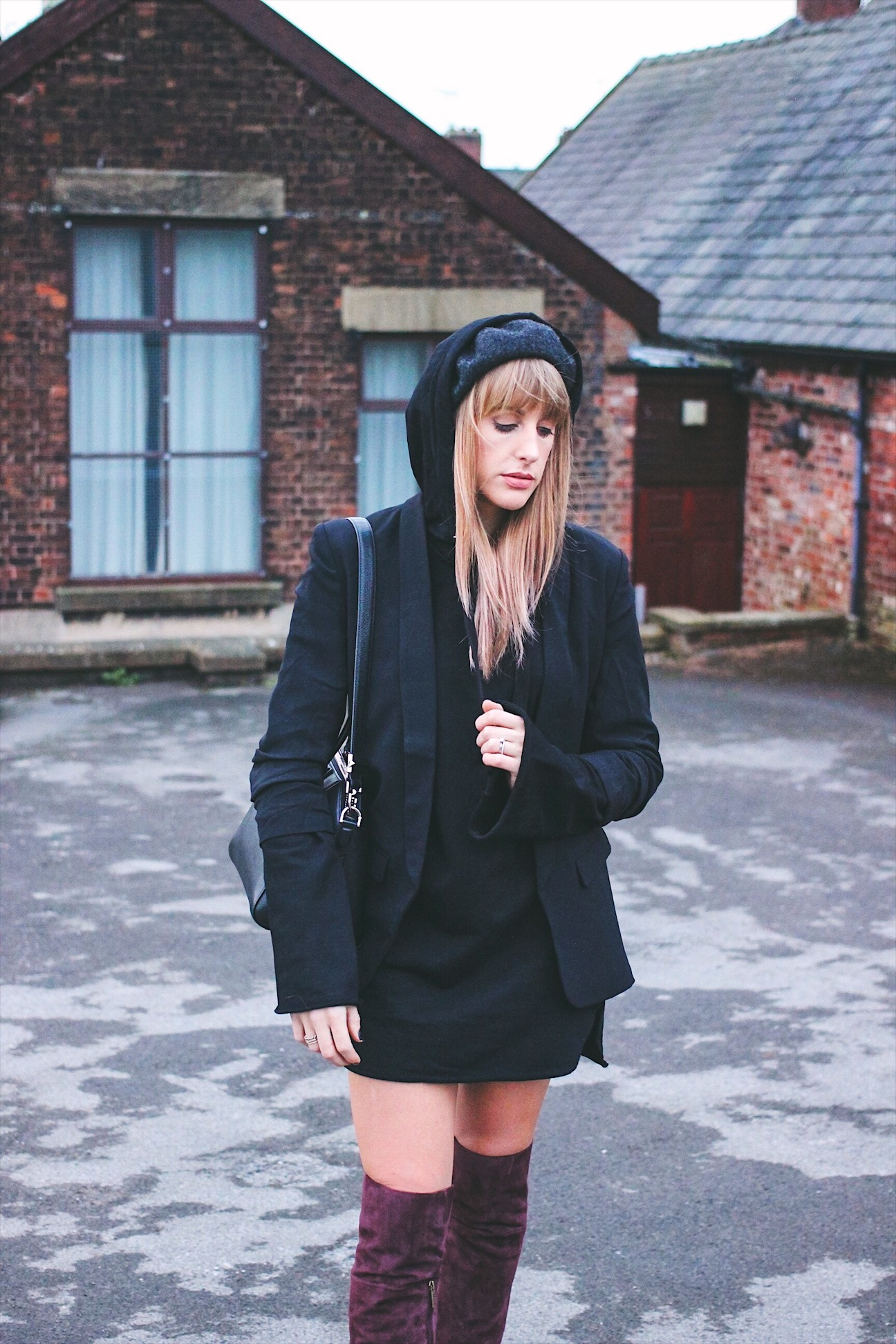 Black oversize hooded dress on UK style blogger